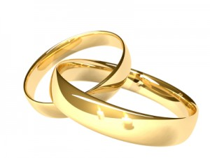 Two gold rings - reflected candles